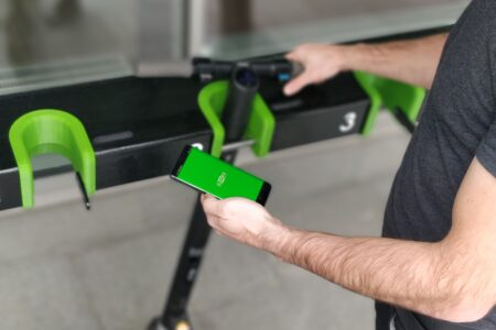 Using an app to unlock the e-scooter station